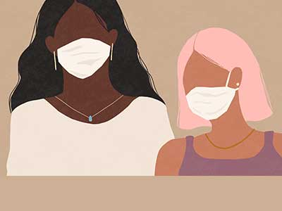 Two women both wearing face masks.